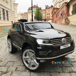 Электромобиль Volkswagen Touareg черный (колеса резина, кресло кожа, пульт, звуковые эффекты)