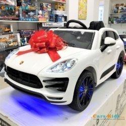 Электромобиль Porsche Cayenne A555AA белый (легкосъемный аккумулятор, колеса резина, кресло кожа, пульт, музыка)